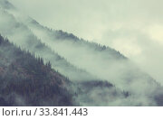 Купить «Beautiful morning scene in the mountains. Fog at sunrise.», фото № 33841443, снято 27 мая 2020 г. (c) easy Fotostock / Фотобанк Лори
