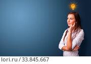 Young person looking for new idea with lighting bulb concept. Стоковое фото, фотограф Zoonar.com/ranczandras / easy Fotostock / Фотобанк Лори