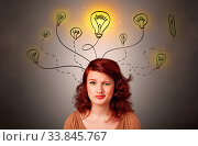 Pretty girl with draw bulbs above her head with different solutions concept. Стоковое фото, фотограф Zoonar.com/ranczandras / easy Fotostock / Фотобанк Лори