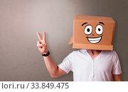 Купить «Young boy standing and gesturing with a cardboard box on his head», фото № 33849475, снято 2 июля 2020 г. (c) easy Fotostock / Фотобанк Лори
