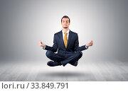 Купить «Businessman levitates and sitting in yoga position in an empty infinity space», фото № 33849791, снято 26 мая 2020 г. (c) easy Fotostock / Фотобанк Лори
