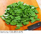 Купить «Sliced green beans on a wooden board», фото № 33851675, снято 31 мая 2020 г. (c) Яков Филимонов / Фотобанк Лори