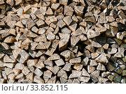 Купить «Дрова, фон. Wooden background with pile of stacked firewood prepared for fireplace and boiler», фото № 33852115, снято 12 мая 2018 г. (c) Зезелина Марина / Фотобанк Лори
