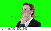 Profile of a Caucasian woman thinking on green background. Стоковое видео, агентство Wavebreak Media / Фотобанк Лори