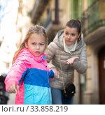 Купить «Angry naughty girl with worried mother outdoors», фото № 33858219, снято 28 мая 2020 г. (c) Яков Филимонов / Фотобанк Лори