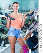 girl choosing pair of shoes in boutique. Стоковое фото, фотограф Яков Филимонов / Фотобанк Лори