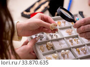 Young woman visiting old male jeweler. Стоковое фото, фотограф Elnur / Фотобанк Лори