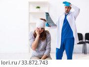 Купить «Young head injured woman visiting young male doctor», фото № 33872743, снято 20 сентября 2019 г. (c) Elnur / Фотобанк Лори