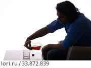 Купить «Young man suffering from alcoholism», фото № 33872839, снято 10 сентября 2019 г. (c) Elnur / Фотобанк Лори