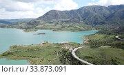 Купить «Panoramic view of Zahara lake in front of mountain range in Sierra de Grazalema Natural Park, Spain», видеоролик № 33873091, снято 18 апреля 2019 г. (c) Яков Филимонов / Фотобанк Лори