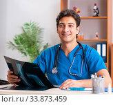 Купить «Young handsome doctor radiologyst working in clinic», фото № 33873459, снято 10 августа 2018 г. (c) Elnur / Фотобанк Лори