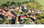 Купить «Aerial view of typical village Cakov in the Czech Republic», видеоролик № 33873831, снято 12 октября 2019 г. (c) Яков Филимонов / Фотобанк Лори