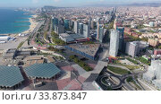 Купить «Aerial panoramic view of Barcelona modern neighborhood of Diagonal Mar i el Front Maritim del Poblenou on Mediterranean coast, Spain», видеоролик № 33873847, снято 4 октября 2019 г. (c) Яков Филимонов / Фотобанк Лори