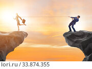 Купить «Boss holding his employee in retention concept», фото № 33874355, снято 5 июня 2020 г. (c) Elnur / Фотобанк Лори