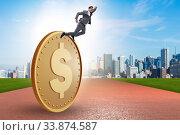 Купить «Businessman with giant golden dollar coin», фото № 33874587, снято 6 июня 2020 г. (c) Elnur / Фотобанк Лори