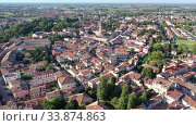 Купить «Aerial view of residential areas of Italian town of Portogruaro in sunny autumn day», видеоролик № 33874863, снято 4 сентября 2019 г. (c) Яков Филимонов / Фотобанк Лори