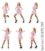 Купить «Young girl with colourful clothing on white», фото № 33875107, снято 25 октября 2013 г. (c) Elnur / Фотобанк Лори