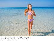 Купить «Adorable little girl have fun at tropical beach during vacation», фото № 33875427, снято 20 февраля 2020 г. (c) Дмитрий Травников / Фотобанк Лори