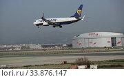 Купить «Airplane Raynayr airline lands on the runway in an aeroport El Prat city of Barcelona», видеоролик № 33876147, снято 24 января 2020 г. (c) Яков Филимонов / Фотобанк Лори