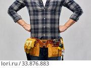 Купить «male worker or builder with working tools on belt», фото № 33876883, снято 21 ноября 2019 г. (c) Syda Productions / Фотобанк Лори