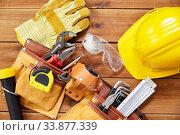 Купить «different work tools in belt on wooden boards», фото № 33877339, снято 26 ноября 2019 г. (c) Syda Productions / Фотобанк Лори