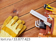 Купить «different work tools in belt on wooden boards», фото № 33877423, снято 26 ноября 2019 г. (c) Syda Productions / Фотобанк Лори