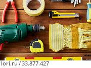 Купить «different work tools on wooden boards», фото № 33877427, снято 26 ноября 2019 г. (c) Syda Productions / Фотобанк Лори