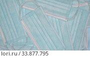 Купить «Falling medical face masks. Close-up slow motion view of flying lot blue surgical respirator bandage for person face», видеоролик № 33877795, снято 12 мая 2020 г. (c) А. А. Пирагис / Фотобанк Лори