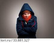 Купить «Handsome young boy freezing in warm clothing with copy space», фото № 33881327, снято 30 мая 2020 г. (c) easy Fotostock / Фотобанк Лори