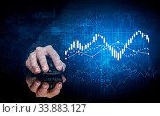 Купить «Hand using wireless mouse with statistical concept on dark background», фото № 33883127, снято 5 августа 2020 г. (c) easy Fotostock / Фотобанк Лори