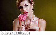 Woman lick lollipop confection and dance seductive. Стоковое видео, видеограф Gennadiy Poznyakov / Фотобанк Лори