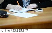Купить «Hands of an official, businessman serving on the table. Meeting», видеоролик № 33885847, снято 29 мая 2020 г. (c) Mikhail Erguine / Фотобанк Лори