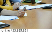 Купить «Hands of an official, businessman serving on the table. Meeting», видеоролик № 33885851, снято 29 мая 2020 г. (c) Mikhail Erguine / Фотобанк Лори