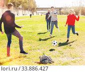 Купить «Teenagers playing football outdoors», фото № 33886427, снято 6 июня 2020 г. (c) Яков Филимонов / Фотобанк Лори