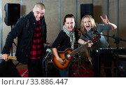 group of rock musicians posing with instruments. Стоковое фото, фотограф Яков Филимонов / Фотобанк Лори