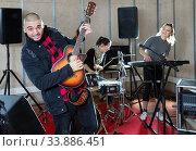 Bearded guy soloist playing guitar in studio. Стоковое фото, фотограф Яков Филимонов / Фотобанк Лори