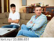 Купить «Worried father at odds with teenager son», фото № 33886651, снято 5 июня 2020 г. (c) Яков Филимонов / Фотобанк Лори