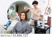 Купить «Stylist doing haircut for woman in salon», фото № 33886727, снято 2 июня 2020 г. (c) Яков Филимонов / Фотобанк Лори