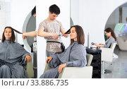 Купить «Man doing haircut for woman in salon», фото № 33886735, снято 1 июня 2020 г. (c) Яков Филимонов / Фотобанк Лори