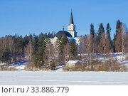 Купить «Старинная лютеранская церковь Руоколахти в зимнем пейзаже. Финляндия», фото № 33886779, снято 3 марта 2018 г. (c) Виктор Карасев / Фотобанк Лори