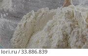 Купить «Close up process of handmade dough from flour. Wooden spoon with flour in a glass bowl . Slow motion, Full HD video, 240fps, 1080p. Process preparing of pastry.», видеоролик № 33886839, снято 31 мая 2020 г. (c) Ярослав Данильченко / Фотобанк Лори