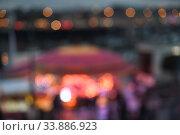 Купить «Blurred background with bokeh of a night city with lights», фото № 33886923, снято 16 ноября 2019 г. (c) Ирина Аринина / Фотобанк Лори