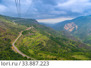 View from the cabin of the cableway to the mountains and the road, the landscape of Armenia in June. Стоковое фото, фотограф Константин Лабунский / Фотобанк Лори