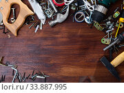 Купить «Various screws, bolts, tools on a wooden table. Space for text», фото № 33887995, снято 12 июля 2020 г. (c) Яков Филимонов / Фотобанк Лори