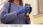 Купить «woman in reusable mask with tumbler in city», видеоролик № 33888951, снято 25 мая 2020 г. (c) Syda Productions / Фотобанк Лори