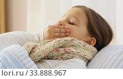 Купить «sick coughing girl lying in bed at home», видеоролик № 33888967, снято 28 мая 2020 г. (c) Syda Productions / Фотобанк Лори