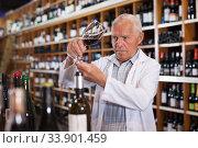 Wine producer inspecting quality of wine. Стоковое фото, фотограф Яков Филимонов / Фотобанк Лори