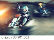Купить «Young woman driving sport car in a circuit lap», фото № 33901563, снято 6 июля 2020 г. (c) Яков Филимонов / Фотобанк Лори
