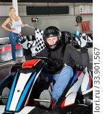 Купить «Male racer crossing finish line on kart track», фото № 33901567, снято 5 июля 2020 г. (c) Яков Филимонов / Фотобанк Лори