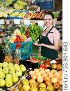Saleswoman holding basket with greengrocery. Стоковое фото, фотограф Яков Филимонов / Фотобанк Лори